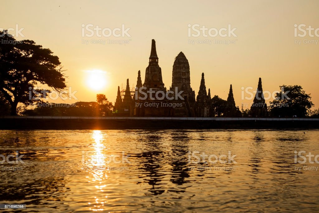 Wat Chaiwatthanaram silhouette on sunset at Ayutthaya, Thailand stock photo