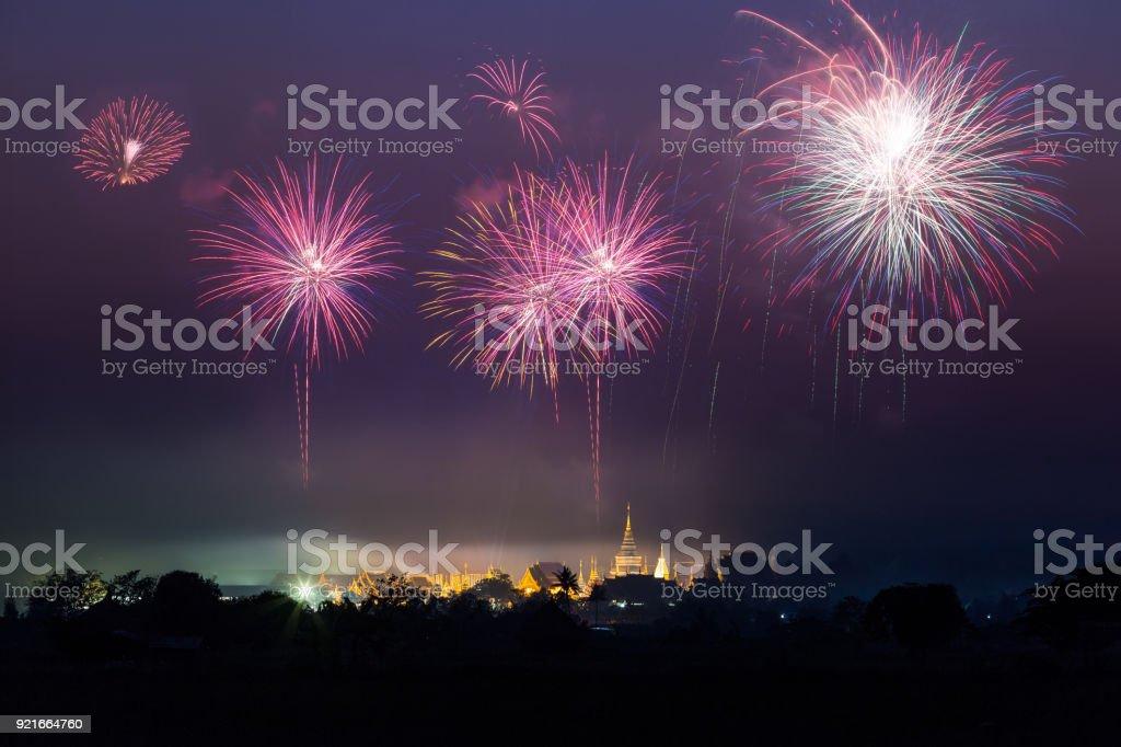 Wat Den Sa Li Mueang Kaen (Ban Den), Inthakit, Mae Taeng, Chiang Mai, Thailand,with beautiful fireworks In celebration stock photo