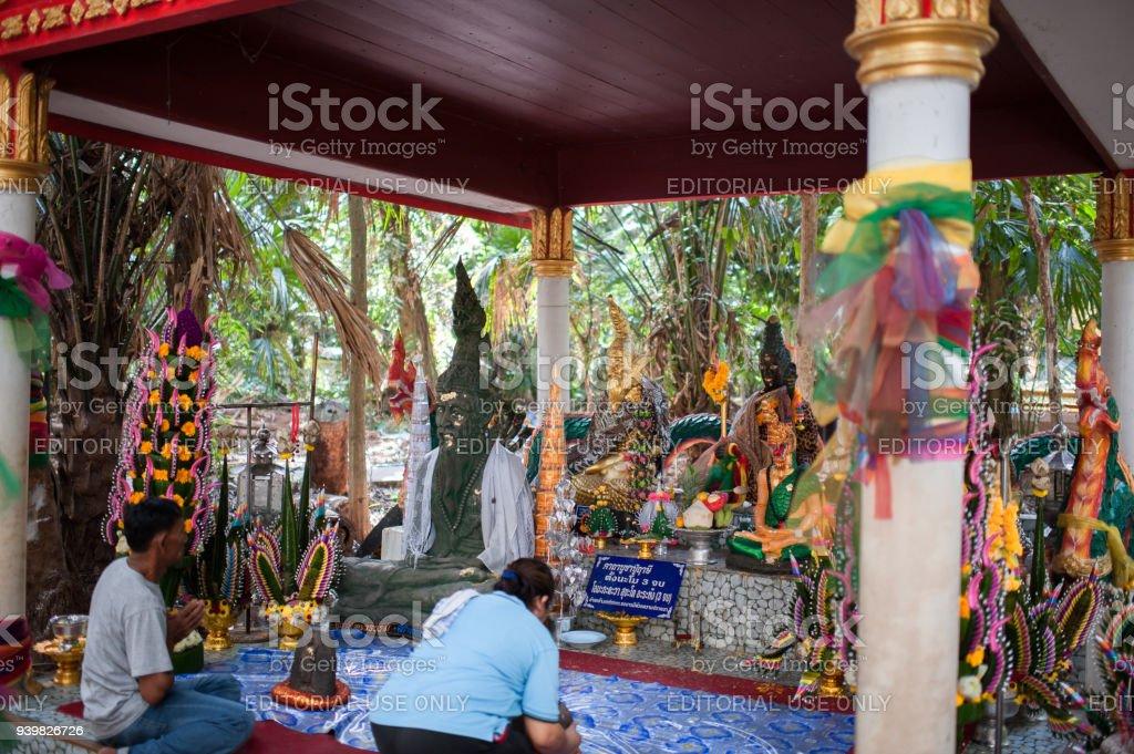 wat kham chanot thailand, province udon thani, praying people at a magic place stock photo