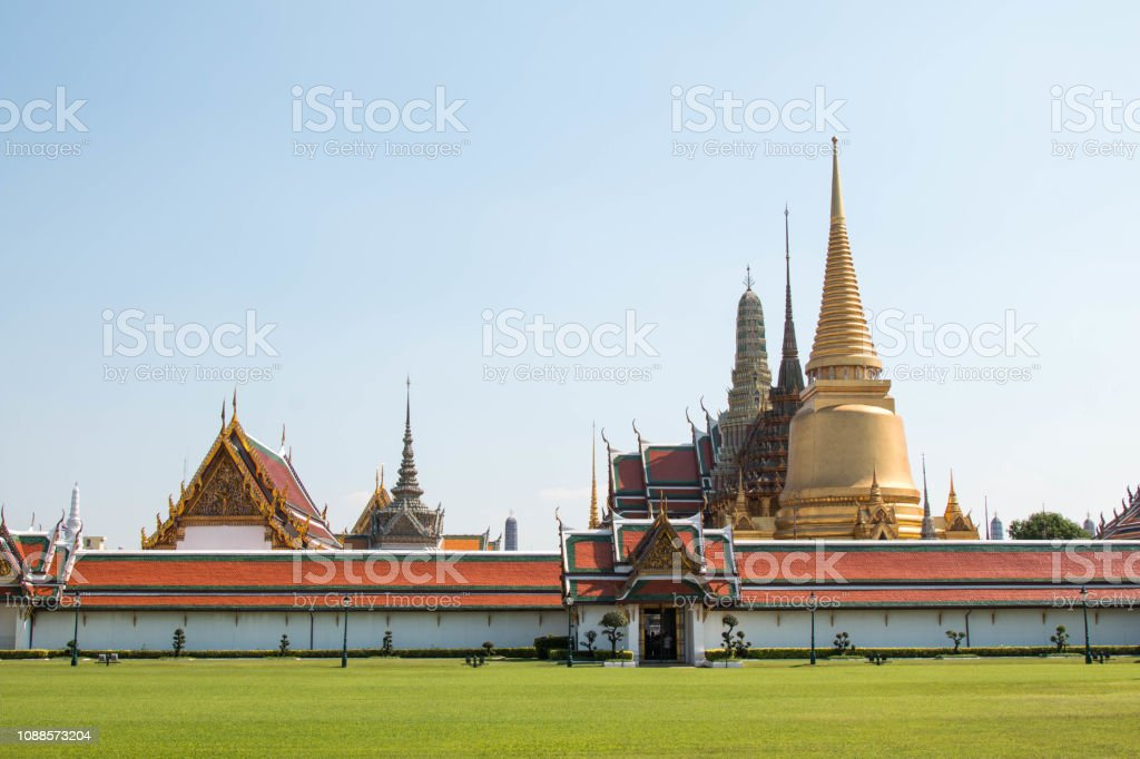 Wat Phra Kaew, Bangkok famous landmark of Thailand, Temple of the Emerald Buddha with blue sky. stock photo
