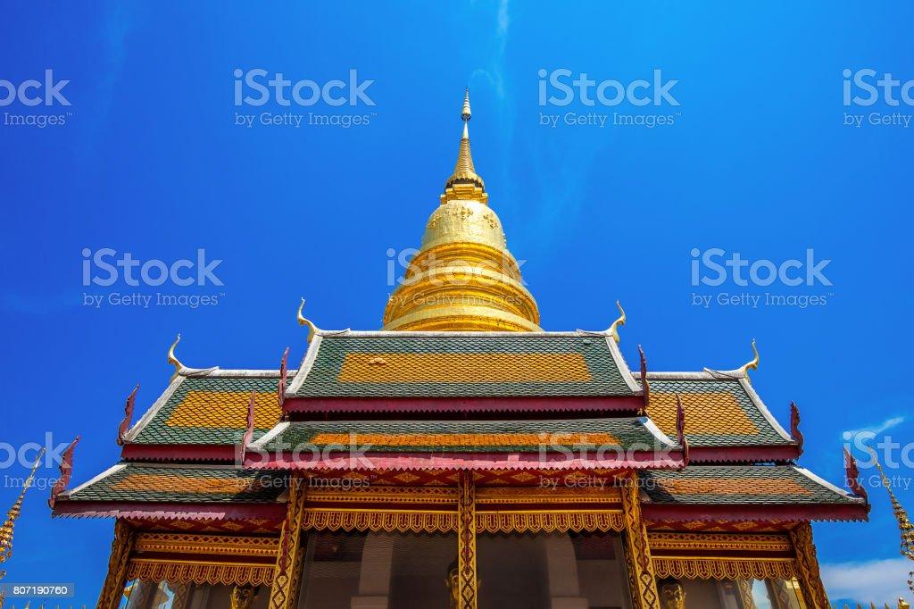 Wat Phrathat Hariphunchai Golden pagoda in Lamphun,Thailand. stock photo