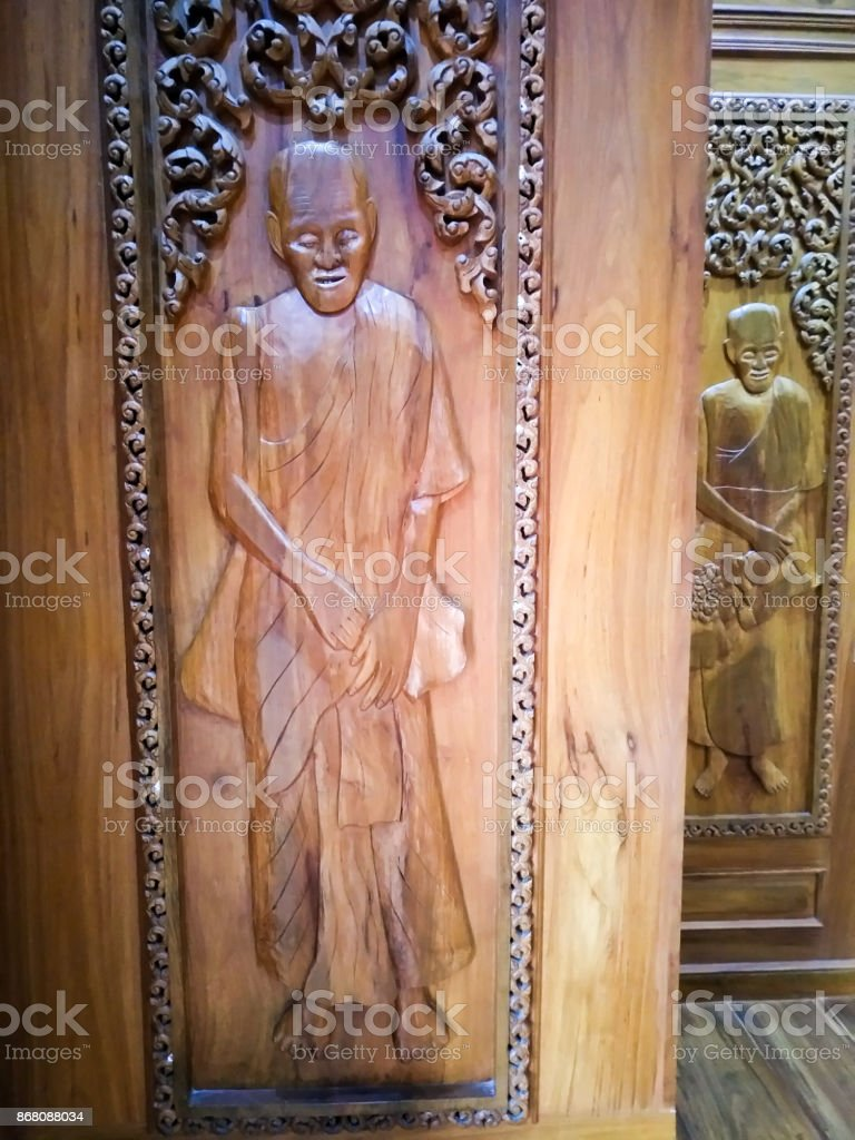 wat pripattana thai stone castle. thai temple khmonk wood carving mer style. Sisaket Province. stock photo