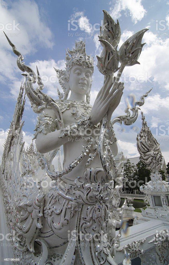 Wat Ron Khun white temple Chiang Rai Thailand statue stock photo