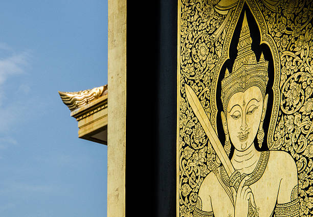 wat traimit golden engravement with blue sky background - engravement stock photos and pictures