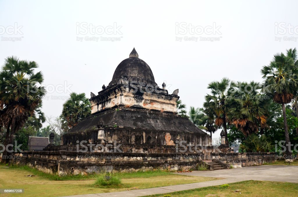 Wat Wisunalat (Visoun) temple and Singhalese style Pra That Makmo or Pra That Pathum stupa stock photo