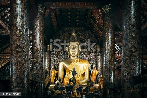 Impessive large Golden Buddha Statue from the 16th century inside the Wat Xienthong Temple, Monastery Complex. Wat Xieng Thong is the most spectacular temple in Lao. Luang Prabang, Laos, Southeast Asia