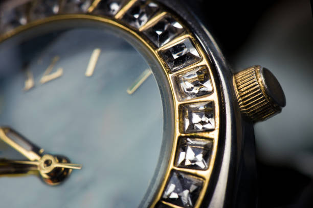 Watch closeup plain Macro close up of watch face with square diamonds around face. luxury watch stock pictures, royalty-free photos & images