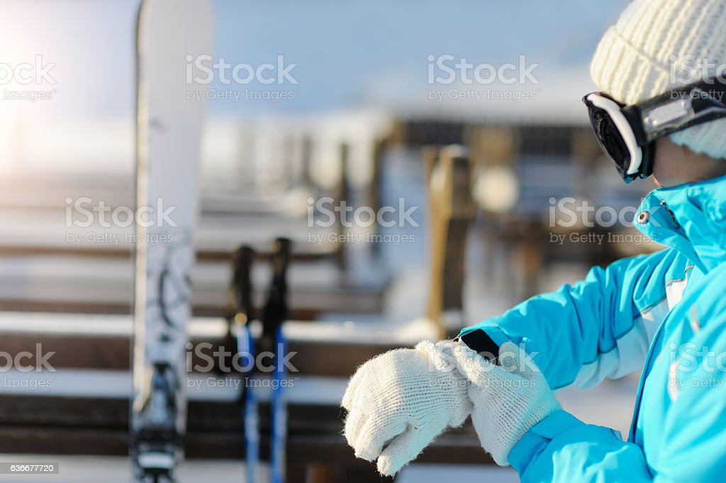 Watch for sport smart watch. Skier on the slope. stock photo