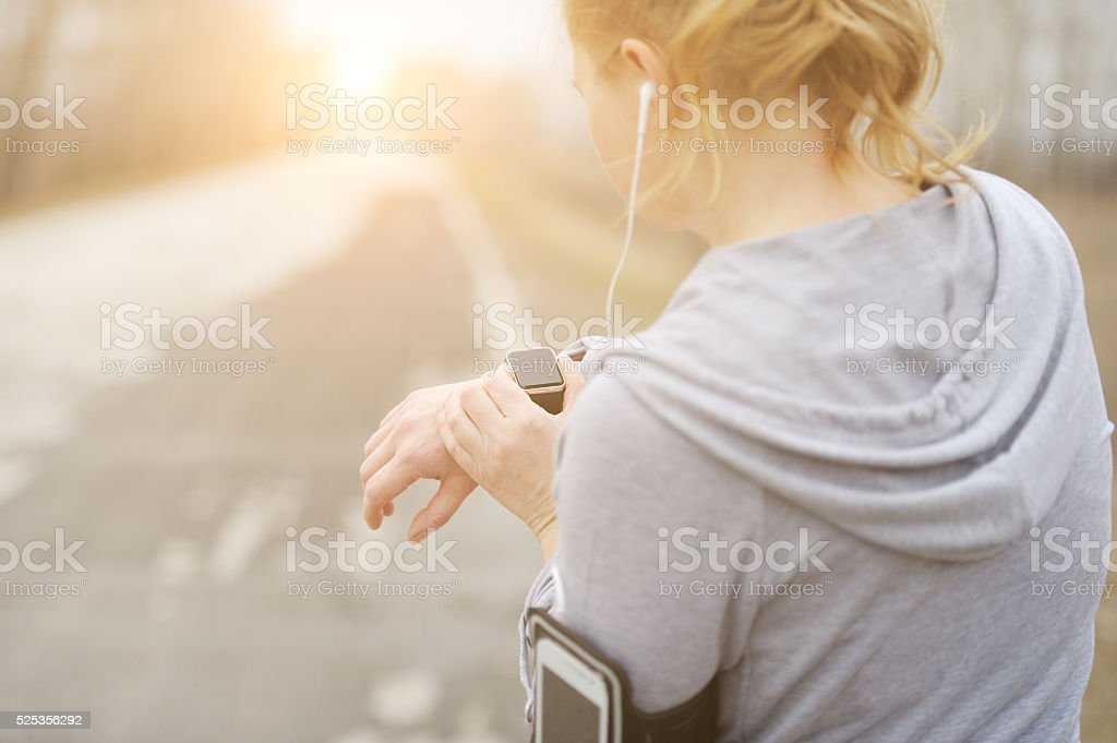 Watch for sports with smartwatch. Jogging training for marathon. stock photo