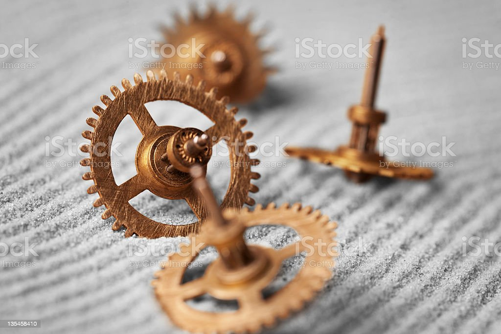 Watch gears on sand - abstract still life royalty-free stock photo