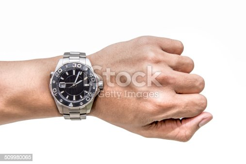 istock Watch on wrist isolated over a white background 509980065