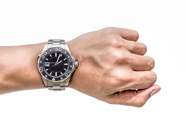 watch on wrist isolated over a white background - watch timepiece stock photos and pictures