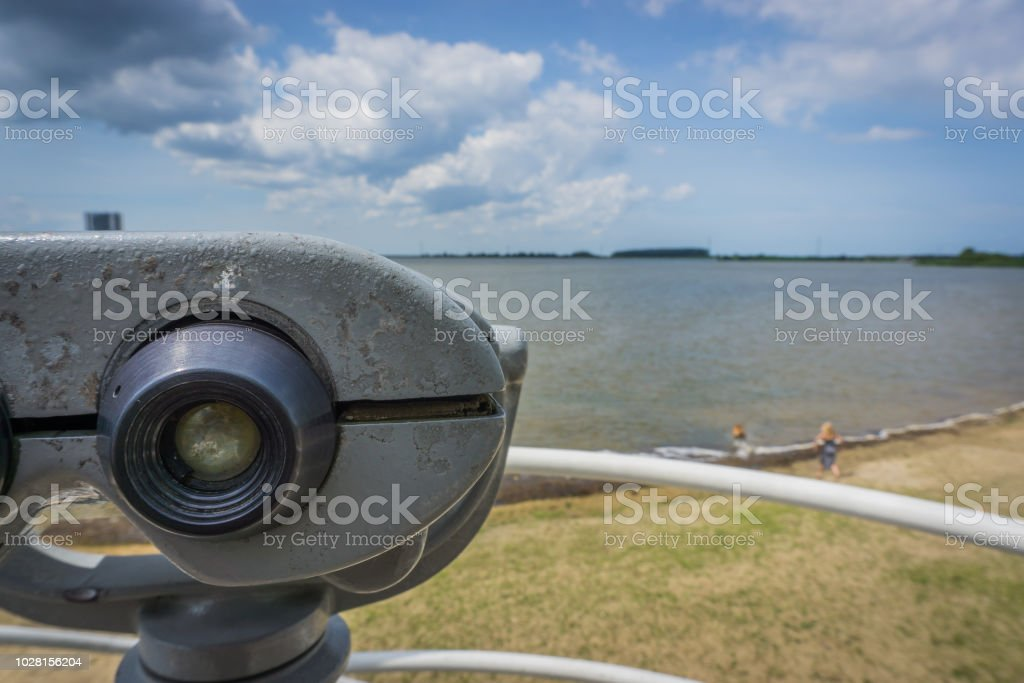 watch tower with binoculars at a beach lake blurry landscape view stock photo