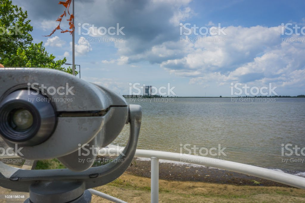 watch tower with binoculars at the city beach lake view stock photo