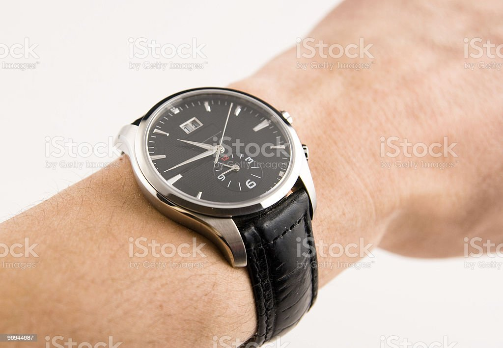 watch with leather strap on the hand royalty-free stock photo