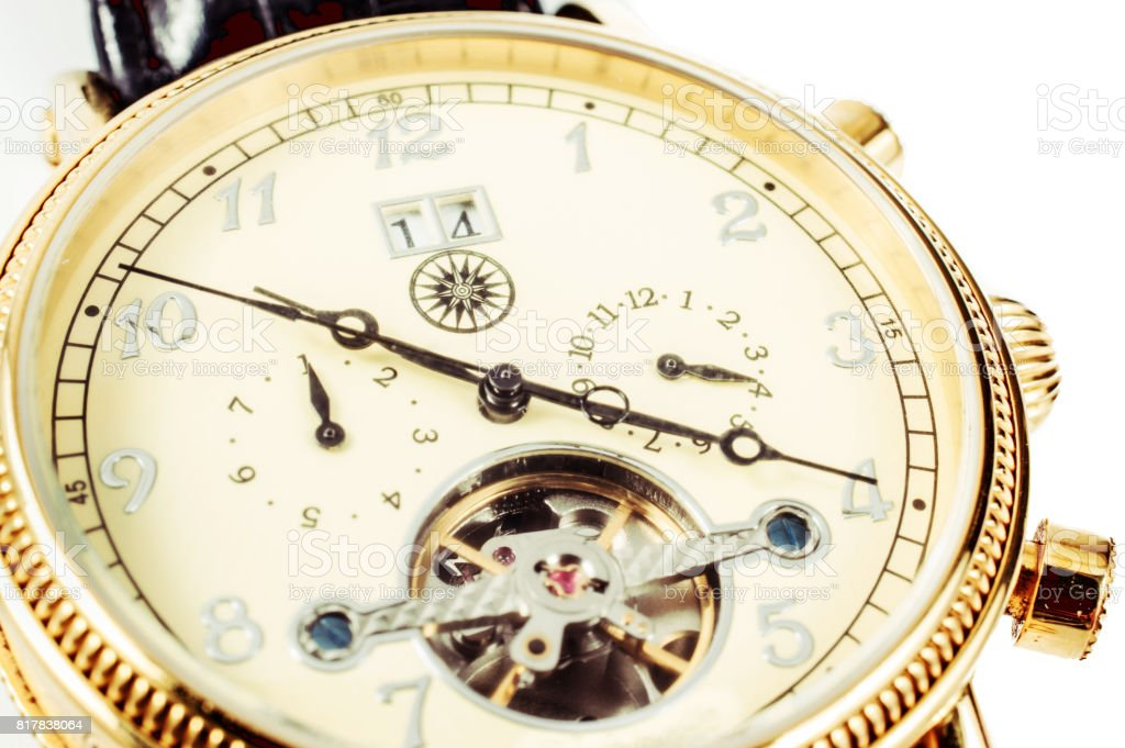 watch with visible mechanism.  men's accessory and time management concept. stock photo