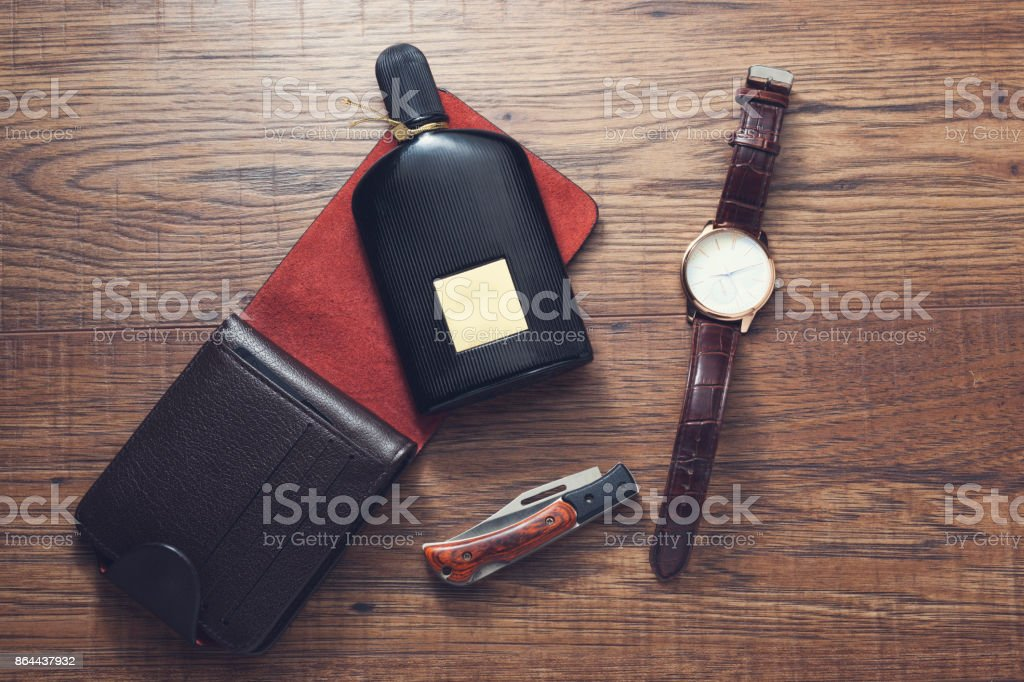 watches, wallet and perfume on wooden background stock photo