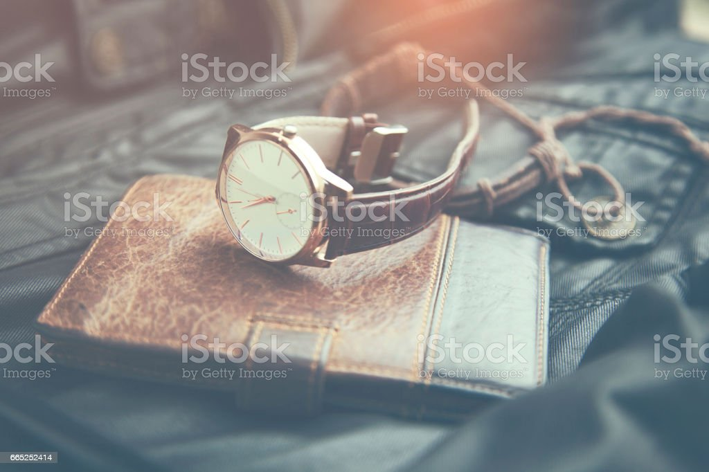 watches, wallet and phone on leather stock photo