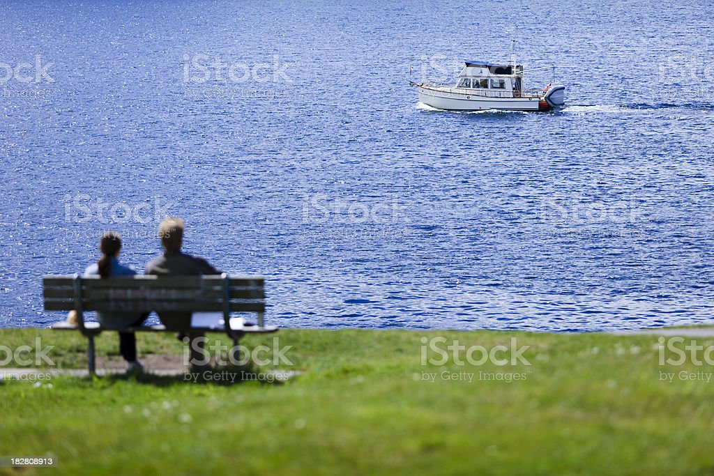 Watching a boat go by stock photo