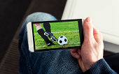 Watching a football match live streamed on mobile phone