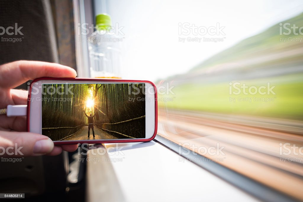 Watching a moive on the go stock photo