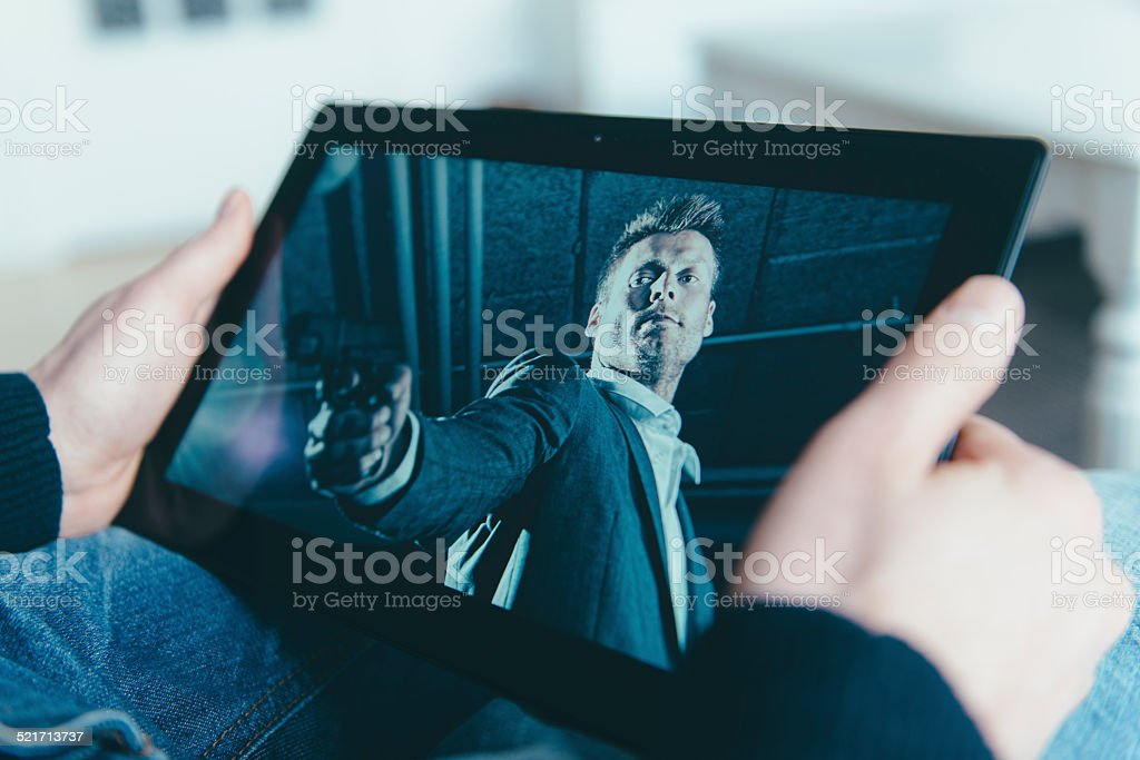 Watching a movie on a digital tablet stock photo