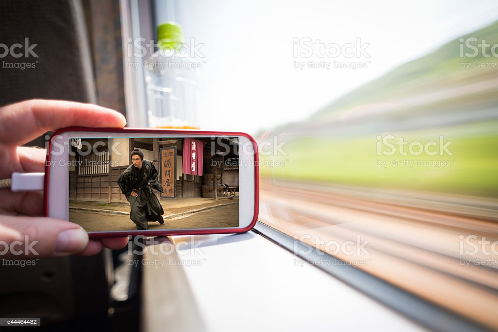 Watching a movie on the go stock photo