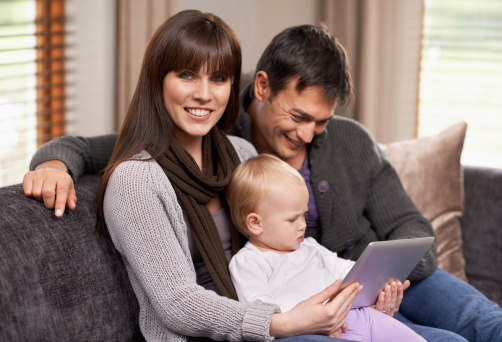 871175856 istock photo Watching a movie with mommy and daddy 477669103