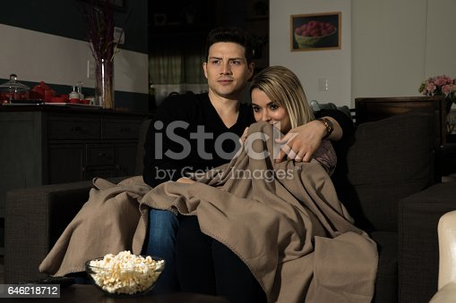 istock Watching a scary movie at night 646218712