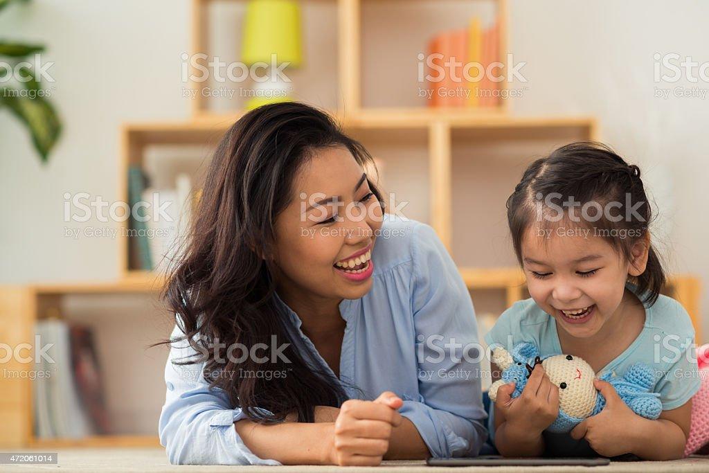 Watching cartoon together stock photo