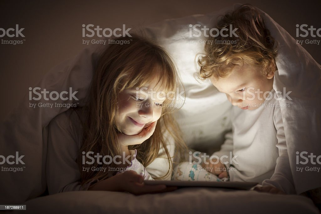 Watching cartoons past bedtime royalty-free stock photo
