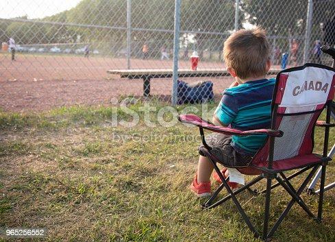 Little Boy sits in