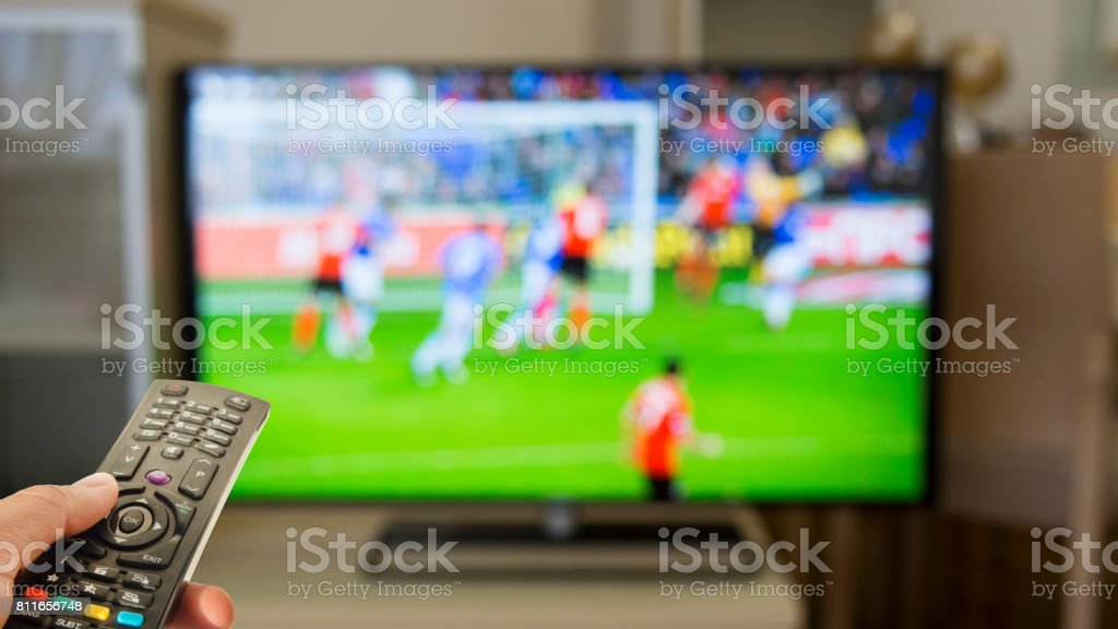 Watching football at home on TV stock photo