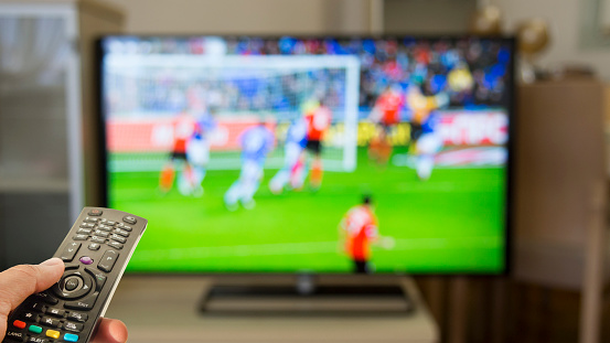 Watching Football At Home On Tv Stock Photo - Download Image Now