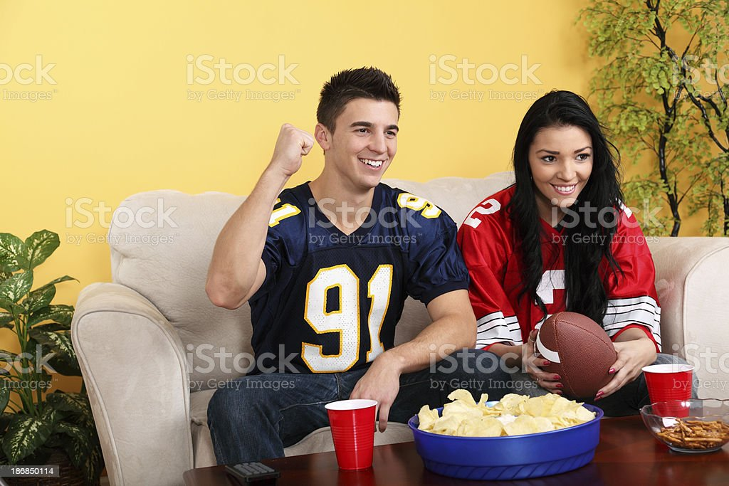 Watching Football Game At Home royalty-free stock photo