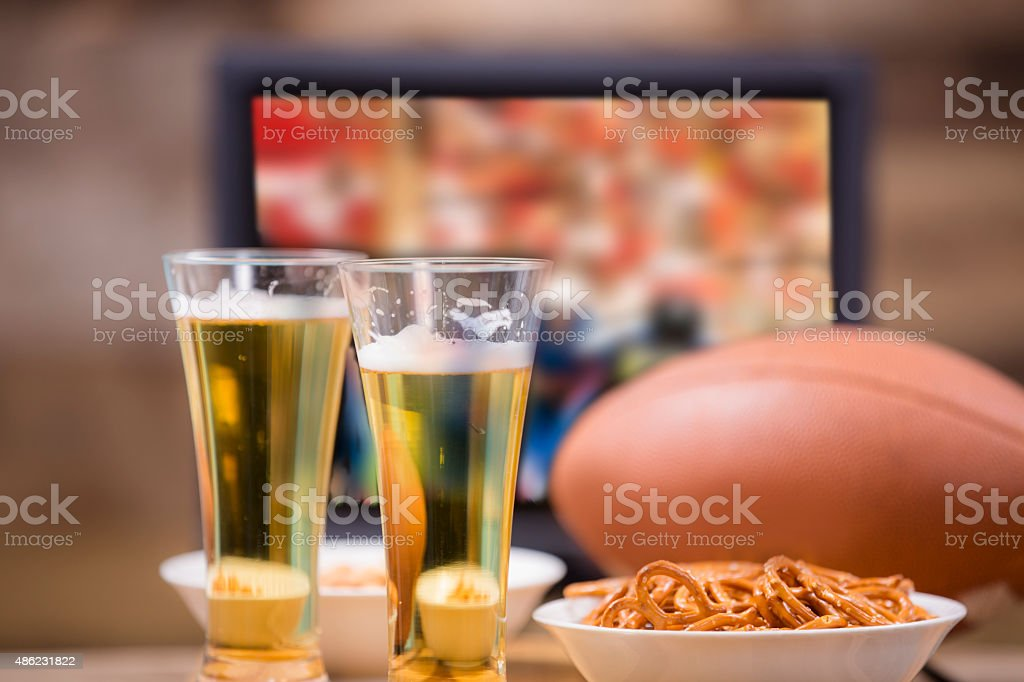 Watching Football Game On Television Snacks Beer Ball Pub Home Stock