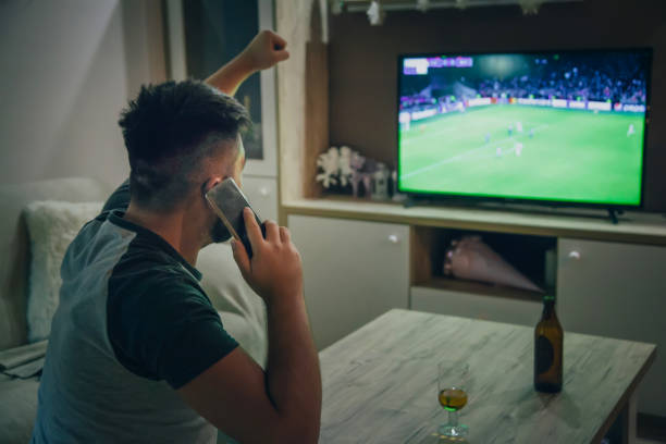 TV watching - football match on TV Soccer, Watching, Sport, Domestic Life, Football, Beer man cave stock pictures, royalty-free photos & images