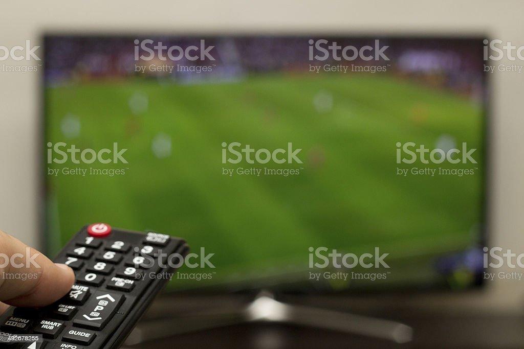 watching football on a smart tv stock photo