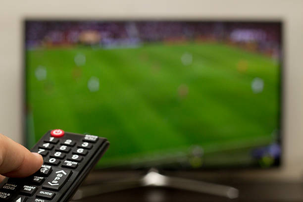 watching football on a smart tv watching football on a wide screen cable tv stock pictures, royalty-free photos & images