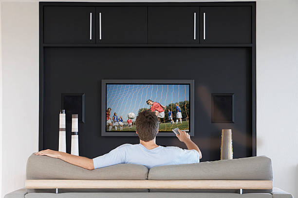 Watching Football Soccer on Television stock photo