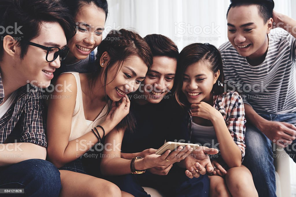 Watching funny photos stock photo