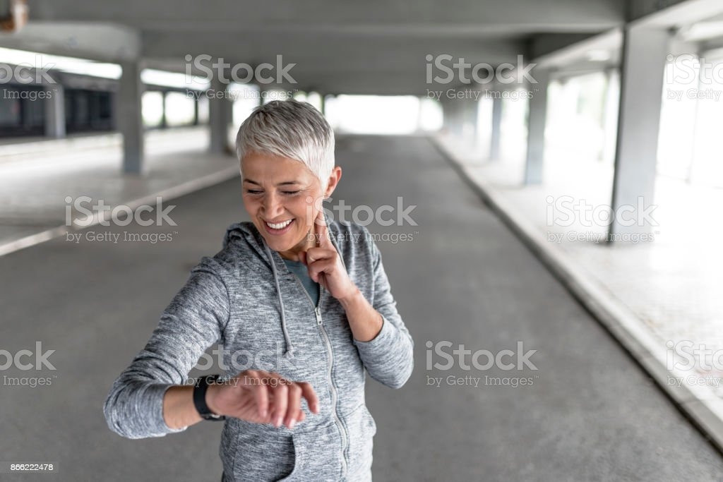 Watching her heart rate stock photo
