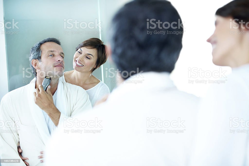 Watching him go through his morning routine stock photo