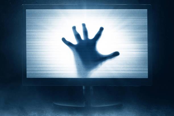 watching horror movie on tv - orrore foto e immagini stock