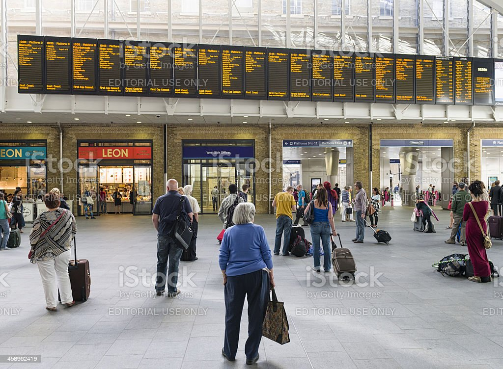 Watching King's Cross Departure Information royalty-free stock photo