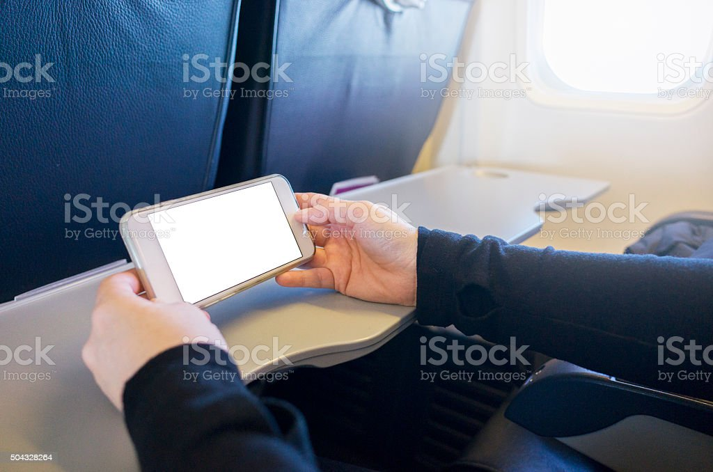 Watching Movie on Smartphone in Passenger Jet Airplane royalty-free stock photo