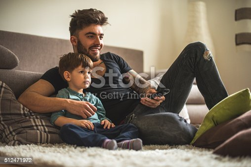 istock Watching movies together 512471972