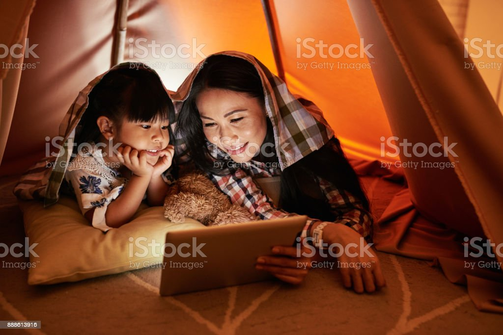 Watching online shows stock photo