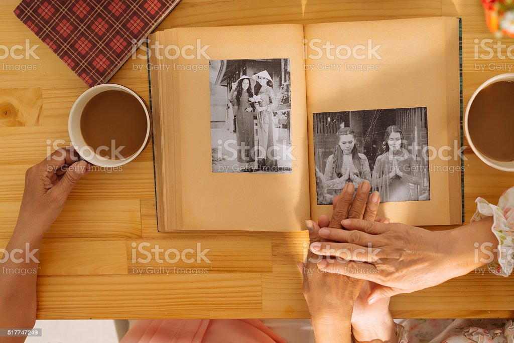 Watching photo album stock photo