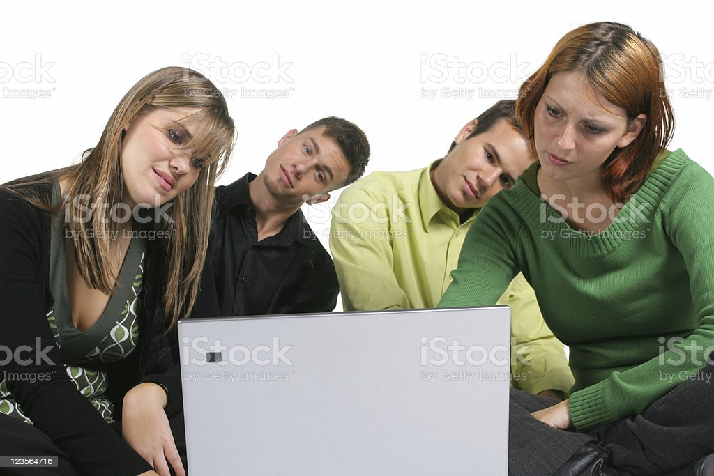 Watching photos Four friends on laptop. Looking not rotated photos ... ;) Adult Stock Photo